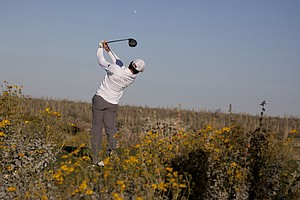 Northern Ireland's Rory McIlroy tees off on the fifth hole while playing Lee Westwood of England during the Match Play Championship.