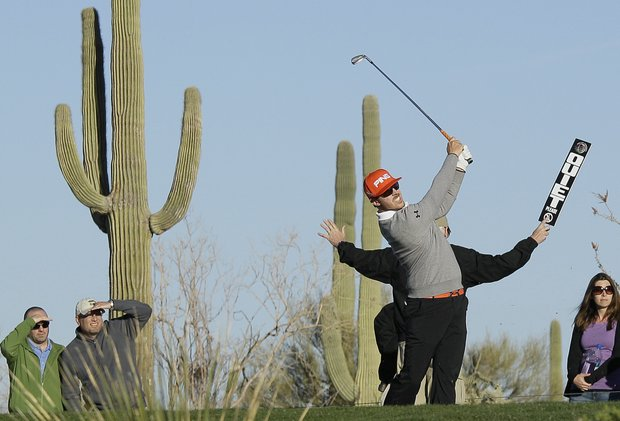 Hunter Mahan tees off of the sixth hole while playing Mark Wilson during the Match Play Championship.