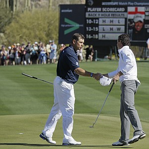 Lee Westwood of England, left, congratulates Rory McIlroy of Northern Ireland on his 3 and 2 semifinal win during the Match Play Championship.