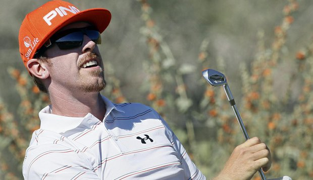 Hunter Mahan watches his tee shot on the 12th hole during the championship match of the WGC-Accenture Match Play Championship.