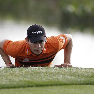 Camilo Villegas of Colombia lines up a putt on the 11th green during the first round of the Honda Classic.