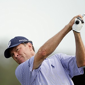 Davis Love III tees off on the 11th hole during the first round of the Honda Classic.