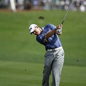 Lee Westwood of England, hits from the first fairway during the first round of the Honda Classic.