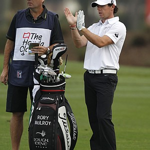 Rory McIlroy of Northern Ireland, right, talks with his caddy, JP Fitzgerald, on the 11th fairway during the first round of the Honda Classic.