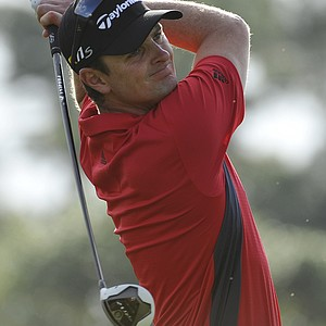 Justin Rose, of England, tees off on the fourth hole during the first round of the Honda Classic.
