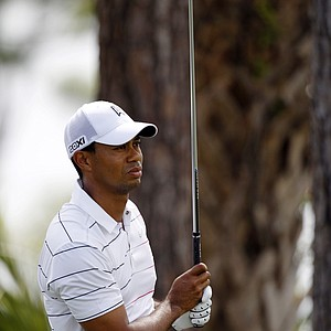 Tiger Woods watches his shot from the second tee during the first round of the Honda Classic.