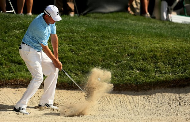 Davis Love III hits from a greenside bunker at No. 17. He is T11 heading into the weekend.