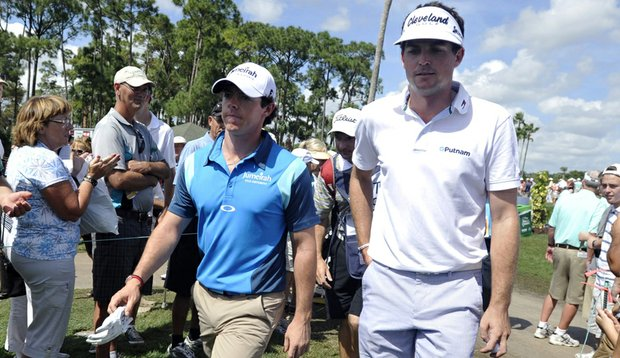 Rory McIlroy, left, and Keegan Bradley walk to the fourth tee during the second round of the Honda Classic.