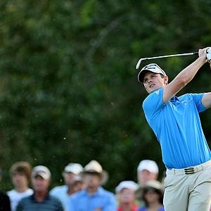 Justin Rose hits a shot at No. 17 at PGA National.
