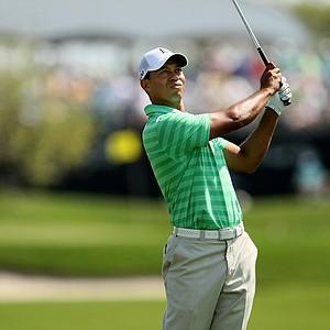 Tiger Woods watches his shot at No. 2 on Saturday at the Honda Classic.