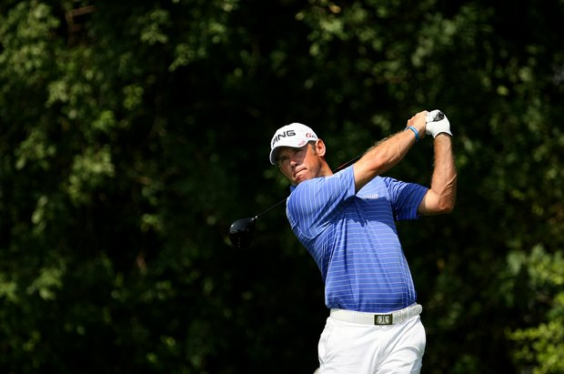 Lee Westwood hits his shot at PGA National's third hole.