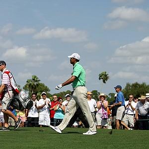 Tiger Woods walks off the tee at No. 1 on Saturday at the Honda Classic.