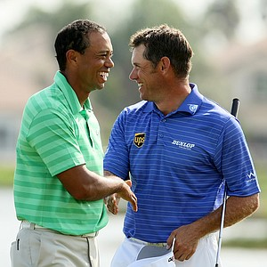 Tiger Woods and Lee Westwood shake hands after the third round of the Honda Classic.