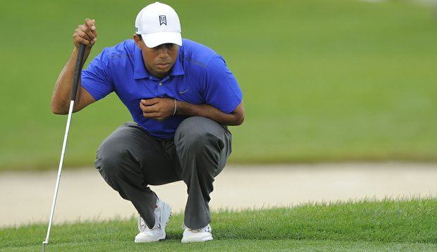 Tiger Woods reads a putt during the third round of the Honda Classic.