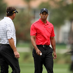 Tiger Woods and playing partner Brandt Jobe mark their balls as play is suspended on Sunday at the Honda Classic at PGA National in Palm Beach Gardens, Fla.
