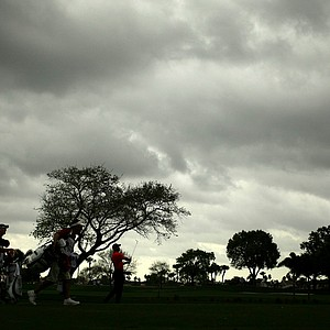 Tiger Woods hits a shot at No. 1 as dark clouds fast approach on Sunday at the Honda Classic at PGA National in Palm Beach Gardens, Fla.