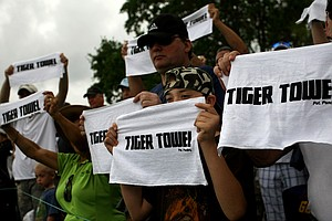 Fans shout for Tiger Woods while showing their Tiger Towel on Sunday at the Honda Classic at PGA National in Palm Beach Gardens, Fla.