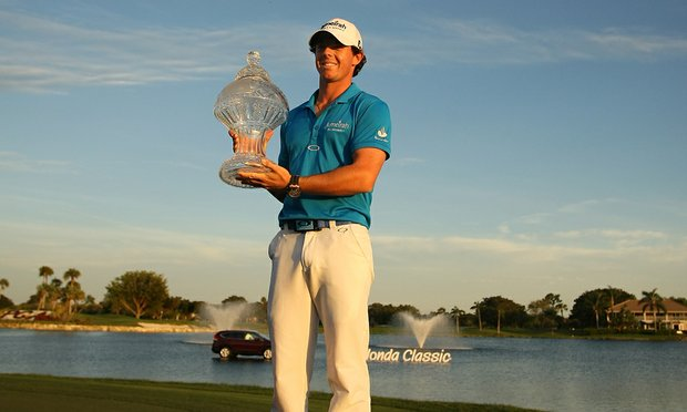 Rory McIlroy poses for pictures on Sunday at the Honda Classic at PGA National in Palm Beach Gardens, Fla. McIlory became the world's No. 1 after winning on Sunday.