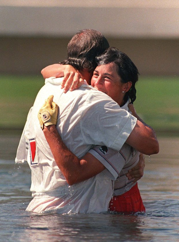 Amy Alcott, right, gets a hug from her caddie, Bill Kurre, after winning the 1988 Nabisco Dinah Shore (now the Kraft Nabisco Championship) and jumping in the lake at Mission Hills Country Club in Rancho Mirage, Calif.