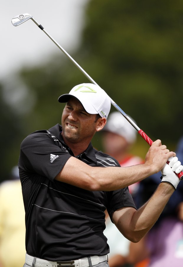 Sergio Garcia of Spain grimaces after hitting off the third tee during Round 1 of the Cadillac Championship.