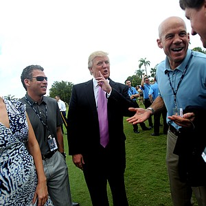 New club owner Donald Trump, center, and his daughter Ivanka, left, chat with PGA Tour Staff on the first tee, including David Pillsbury, second from right, prior to the start of the World Golf Championship at the Doral Golf Resort and Spa.