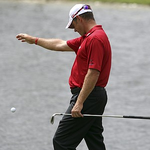 Lee Westwood of England takes a drop on the 10th hole during the first round of the Cadillac Championship.