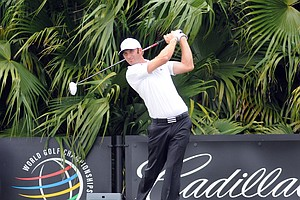 Dustin Johnson hits off the eighth tee at the Blue Monster at Doral.