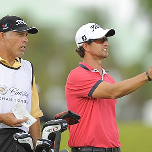 Adam Scott and his caddie Steve Williams during the first round of the WGC-Cadillac Championship.