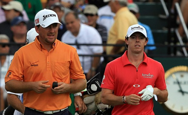 Rory McIlroy and his playing partner Graeme McDowell leave the first tee during the third round of the 2012 WGC-Cadillac Championship.