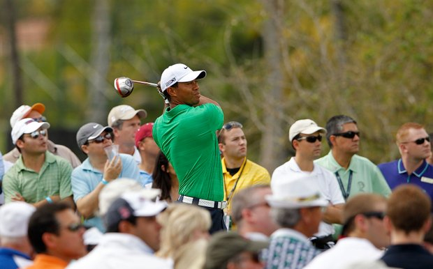 Tiger Woods will play with Webb Simpson at 2 p.m. EDT on Sunday.