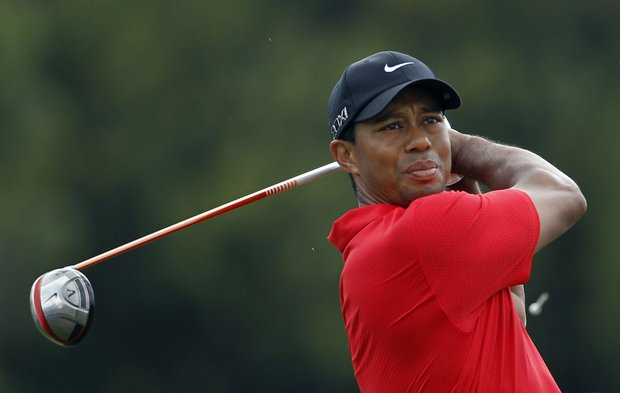 Tiger Woods watches his shot from the third tee, during the final round of the Cadillac Championship.