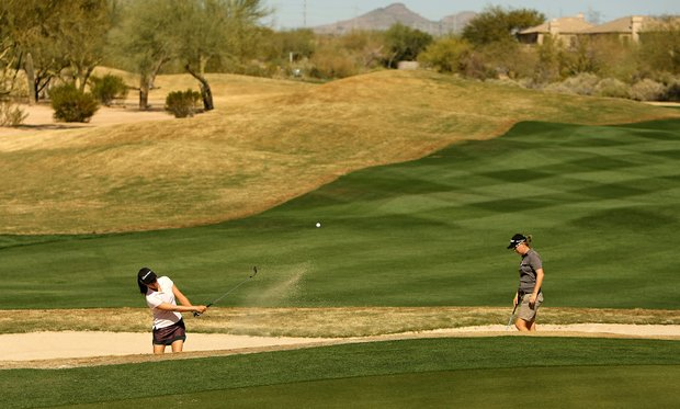 Stephanie Kono, left, practices the bunker on Tuesday during a practice round of RR Donnelley LPGA Founders Cup at Wildfire at Desert Ridge.