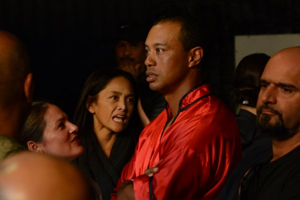 """Tiger Woods looks on as Shaquille O'Neal does his filming for a recent EA Sports commercial for """"Tiger Woods PGA Tour 13."""""""
