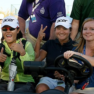 Yani Tseng, center, is brought to the media room after posting a 65 to tie with Hee Young Park during the first round of the RR Donnelley Founders Cup.