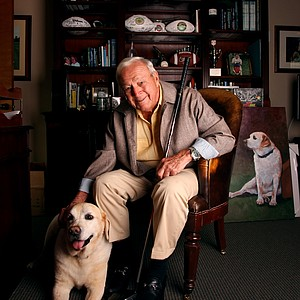 Arnold Palmer photographed in his office with his dog, Mulligan at Bay Hill Club and Lodge.