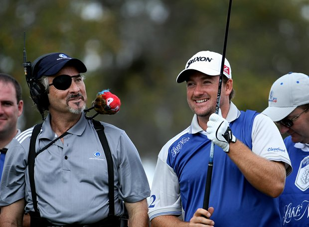 Golf Channel's David Feherty has a little fun with Graeme McDowell of Team Lake Nona on the first tee on Tuesday. Feherty injured his eye on Monday, scratching his cornea.