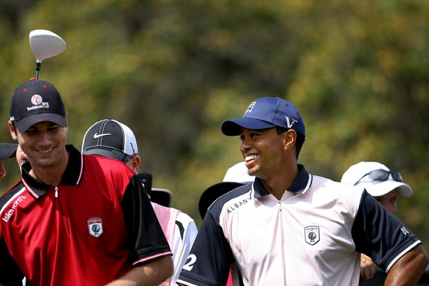 Tiger Woods and Sean O'Hair share a laugh on the first tee on Tuesday during the 2012 Tavistock Cup at Lake Nona Golf and Country Club.