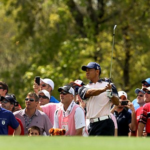 Tiger Woods hits a shot at No. 2 on Tuesday during the 2012 Tavistock Cup at Lake Nona Golf and Country Club.