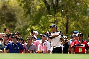 Tiger Woods hits a shot at No. 2 on Tuesday during the 2012 Tavistock Cup at Lake Nona Golf and Country Club.