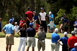Tiger Woods of Team Albany chats with Sean O'Hair of Team Isleworth at No. 6 on Tuesday during the 2012 Tavistock Cup at Lake Nona Golf and Country Club.