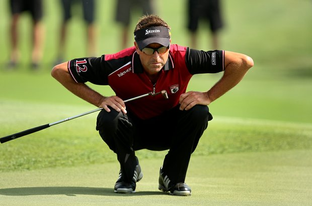 Team Isleworth's Robert Allenby lines up his putt at No. 18.