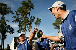 Team Lake Nona's Ross Fisher, far right, Graeme McDowell, far left, and Gary Woodland, center, celebrate their win on Tuesday.