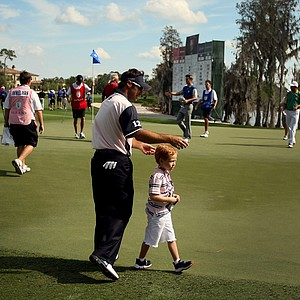 Team Albany's Trevor Immelman walks at No. 18 with his son Jacob on Tuesday during the Tavistock Cup.
