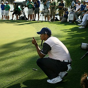 Tiger Woods, playing for Team Albany, gives the thumbs up at No. 18 on Tuesday. Team Lake Nona defended their Tavistock title, with Team Isleworth in second, Team Quenwood in third and Team Albany in fourth.