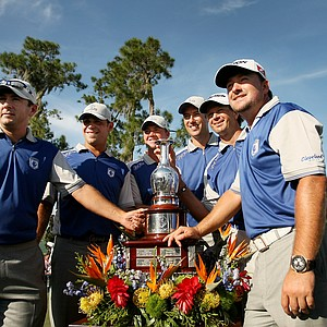 Team Lake Nona poses by the Tavistock Cup on Tuesday after winning at Lake Nona Golf and Country Club.