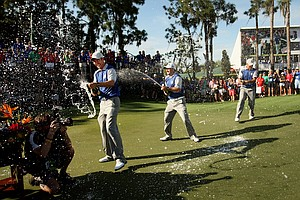 Team Lake Nona's Ross Fisher, left, Graeme McDowell, center, and Gary Woodland, right, celebrate their win on Tuesday, March 20, during the 2012 Tavistock Cup at Lake Nona Golf and Country Club.