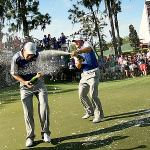 Team Lake Nona's Ross Fisher, left, Graeme McDowell, center, and Gary Woodland, right, celebrate their win on Tuesday.