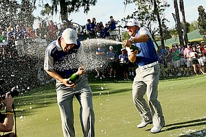 Team Lake Nona's Ross Fisher, left, Graeme McDowell, center, and Gary Woodland, right, celebrate their win on Tuesday during the Tavistock Cup.