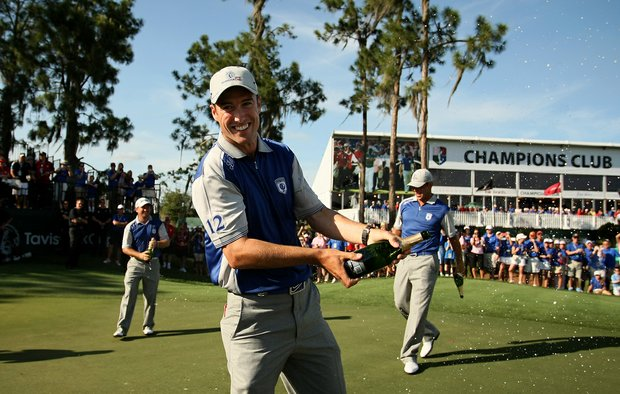 Team Lake Nona's Ross Fisher celebrates with champagne at No. 18 after they won the 2012 Tavistock Cup.