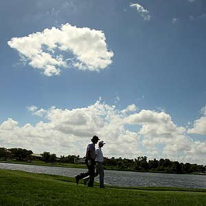 Phil Mickelson and Justin Rose make their way along No. 6 during the first round.